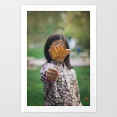 Girl holding leaf Art Print