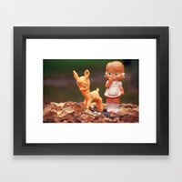 Girl with fawn Framed Art Print