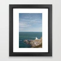 Lighthouse at Hartland Quay with Lundy Island beyond. Devon, UK. Framed Art Print