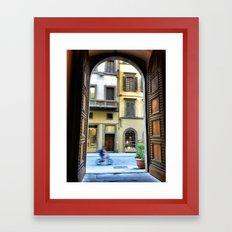 Firenze through a door Framed Art Print