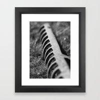 Rake in Grass Framed Art Print