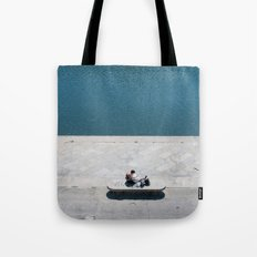 The reader and the river Tote Bag