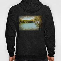 Secluded waterway with boats hidden behind greener Hoody