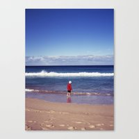 Red jacket and blue ocean Canvas Print