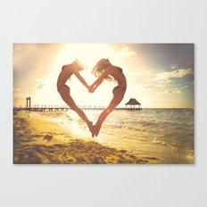 Women Making a Heart on the Beach Canvas Print