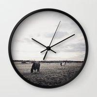 Horses In A Field In Bla… Wall Clock